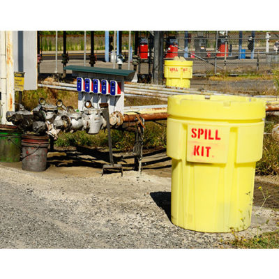 A spill kit container used to store fluids in an industrial environment