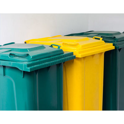 Three green and yellow waste bins