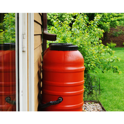 A red rain barrel used to collect rainwater